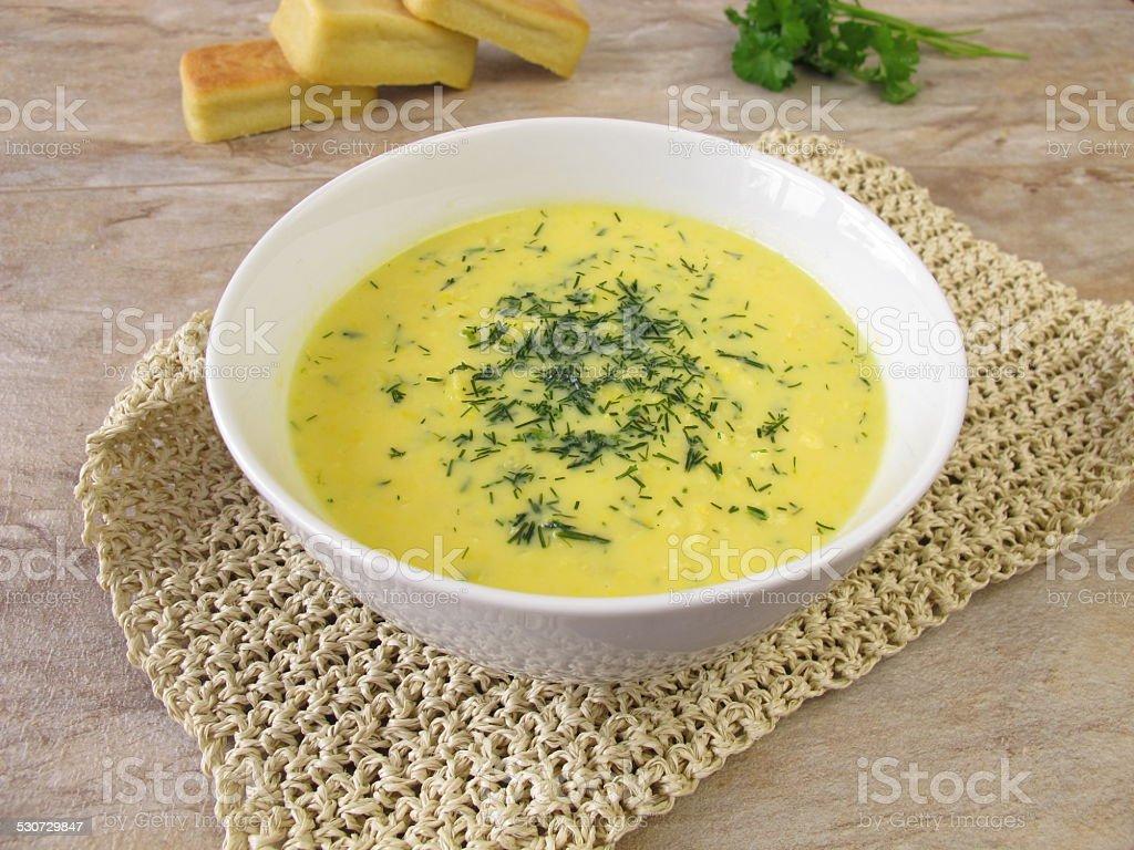 Corn cream soup with garden herbs stock photo