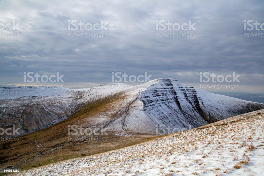 Corn Du and Pen y Fan mountain summits with Winter Snow stock photo
