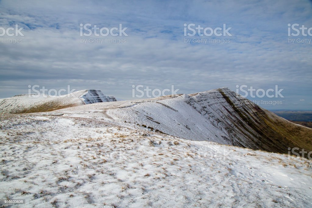 Corn Du, Pen y Fan and Cribyn mountain summits with Winter Snow stock photo