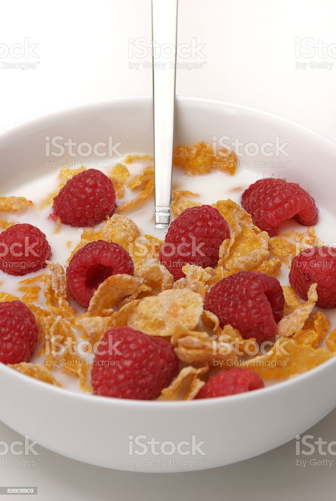 Corn flakes and Raspberries close-up royalty-free stock photo