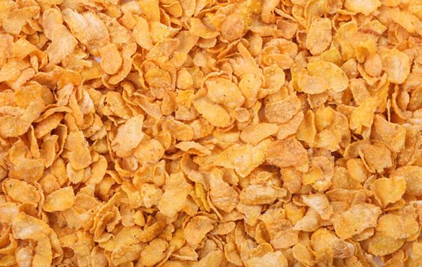 fondo lleno de copos de maíz - corn flakes fotografías e imágenes de stock