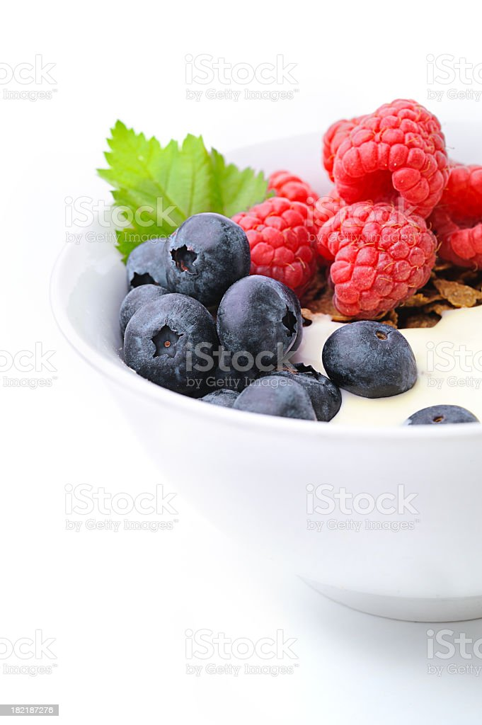 Corn flakes with blueberries and raspberries royalty-free stock photo