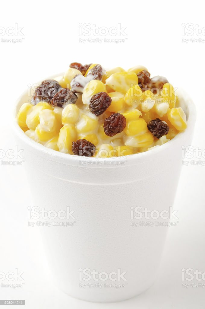 Corn in a cup with mayonnaise and raisins stock photo