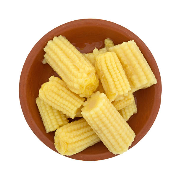 Corn nuggets in small red bowl stock photo