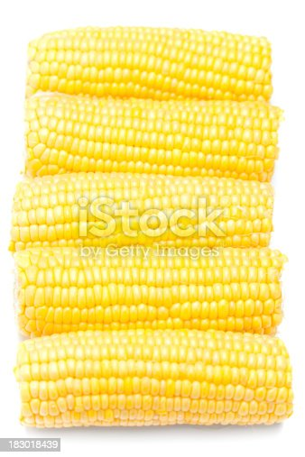 Five ears of corn on the cob isolated on white.  Shallow dof