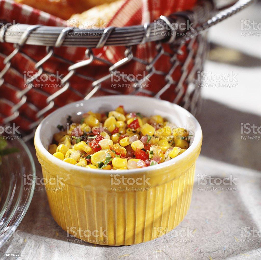 Corn salad in yellow bowl stock photo