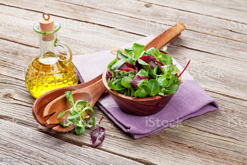 Corn salad leaves and olive oil stock photo