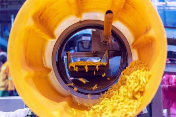 Corn Snacks Coming Passing Through the Tumbling Machine stock photo