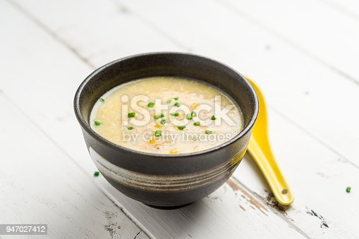 Corn soup on white background. A Cantonese cuisine dish often served as starter food in Chinese restaurants. The bowl of soup is on white background. Egg drop corn soup is delicious and healthy too!