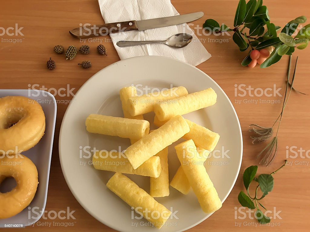 Corn sticks on plate, sweet snack стоковое фото