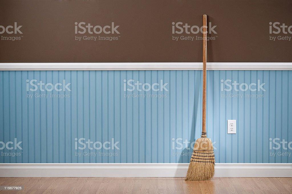 Corn whisk broom standing in empty room stock photo