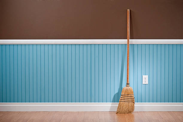 corn whisk broom standing in empty room - sweeping stock pictures, royalty-free photos & images