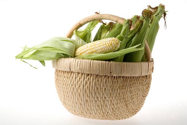 Corncobs in a wicker basket stock photo