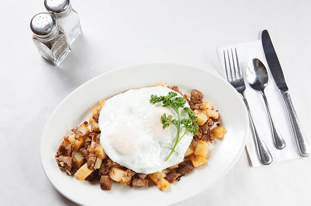 Corned beef hash and egg breakfast stock photo