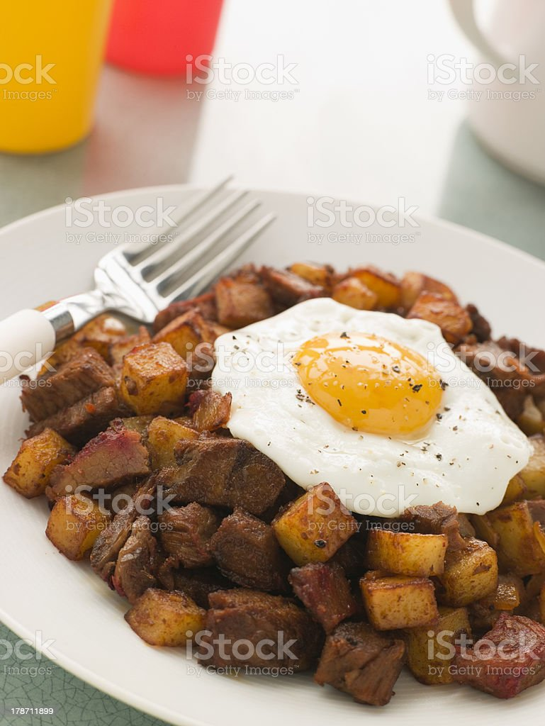 Corned Beef Hash With a Fried Egg and Black Pepper stock photo
