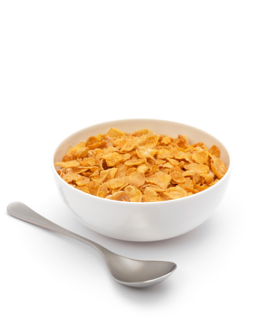 bowl filled with corned flakes and spoon