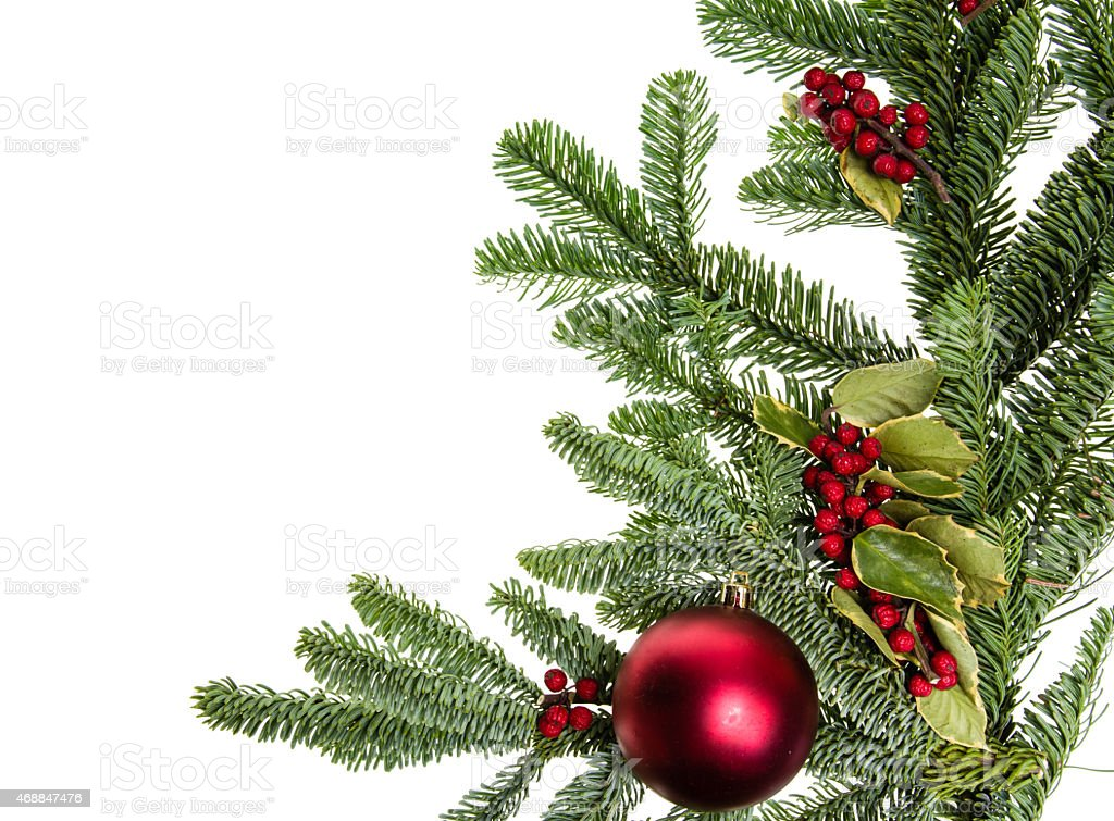 Corner border of nobel fir and red ball stock photo