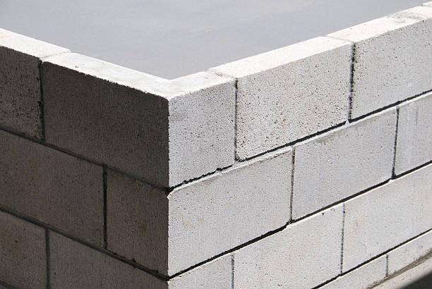 ecke-konstruktion - betonblock wände stock-fotos und bilder
