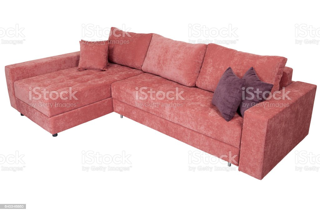 Corner convertible sofa-bed with storage space, upholstery soft pink fabric. stock photo