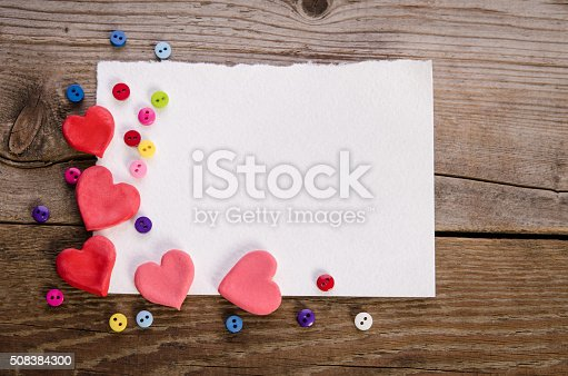 istock Corner for empty card from hearts and colorfull buttons 508384300