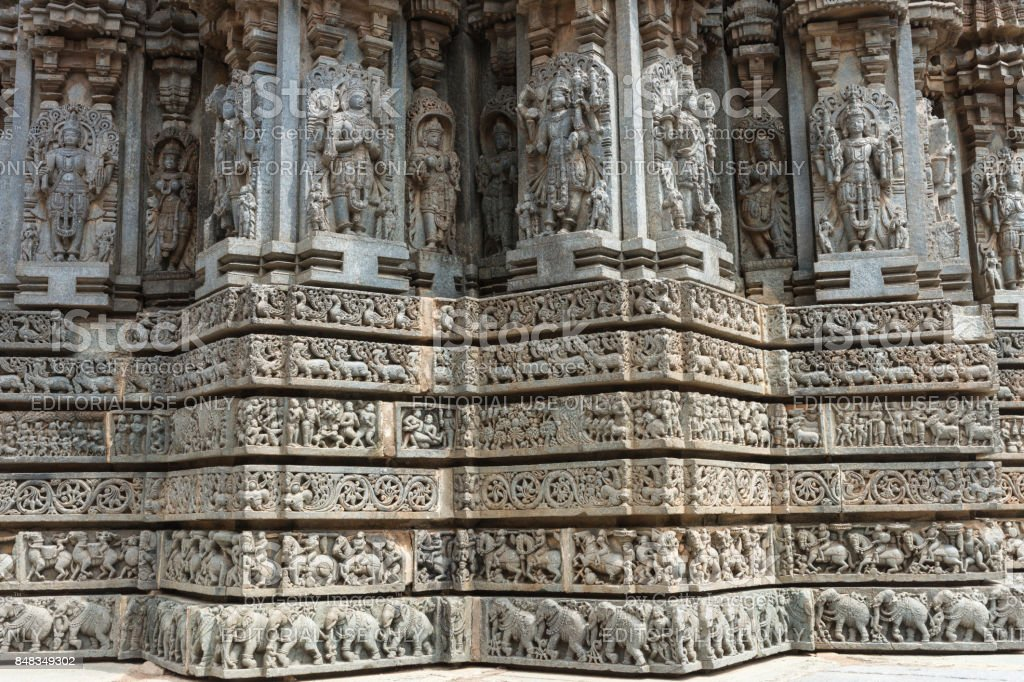 Corner friezes with statues above at Chennakesava Temple, Somanathpur India. stock photo
