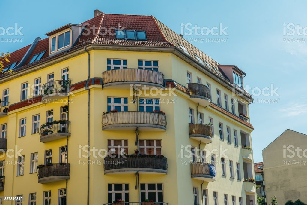 corner house with curved balconies on clean background stock photo