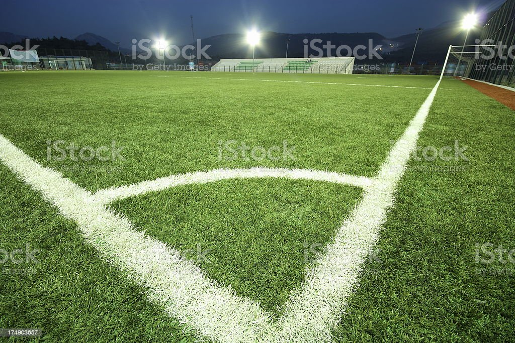 Corner of an empty soccer field at night with lights on stock photo