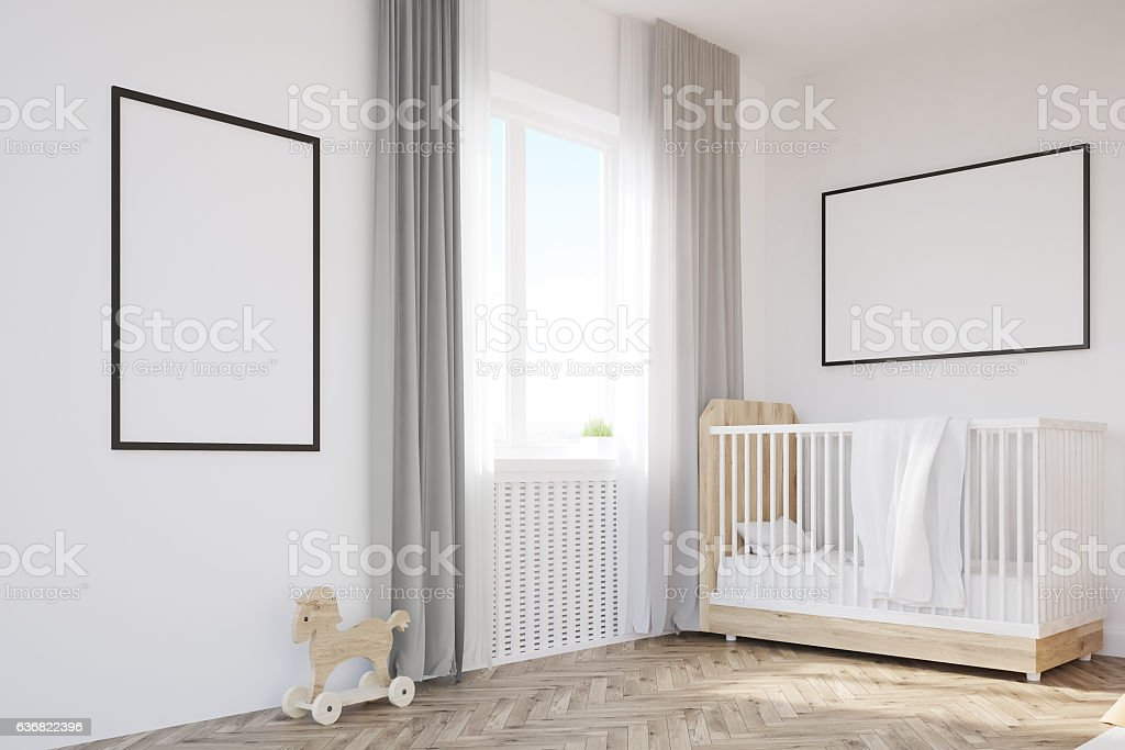 Corner of baby's room with a crib stock photo