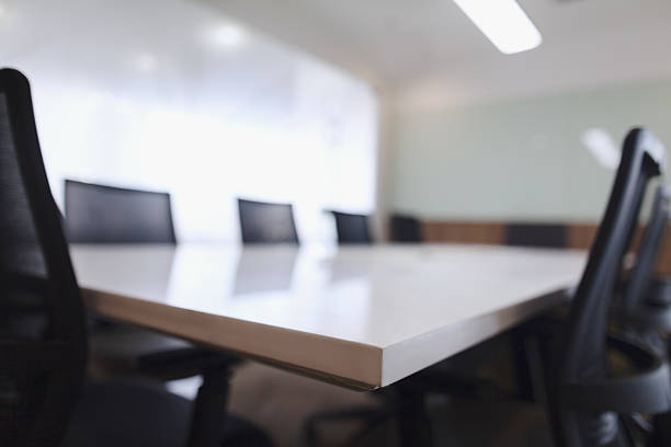 Corner of business conference room table and chairs Corner of business conference room table and chairs governing board stock pictures, royalty-free photos & images