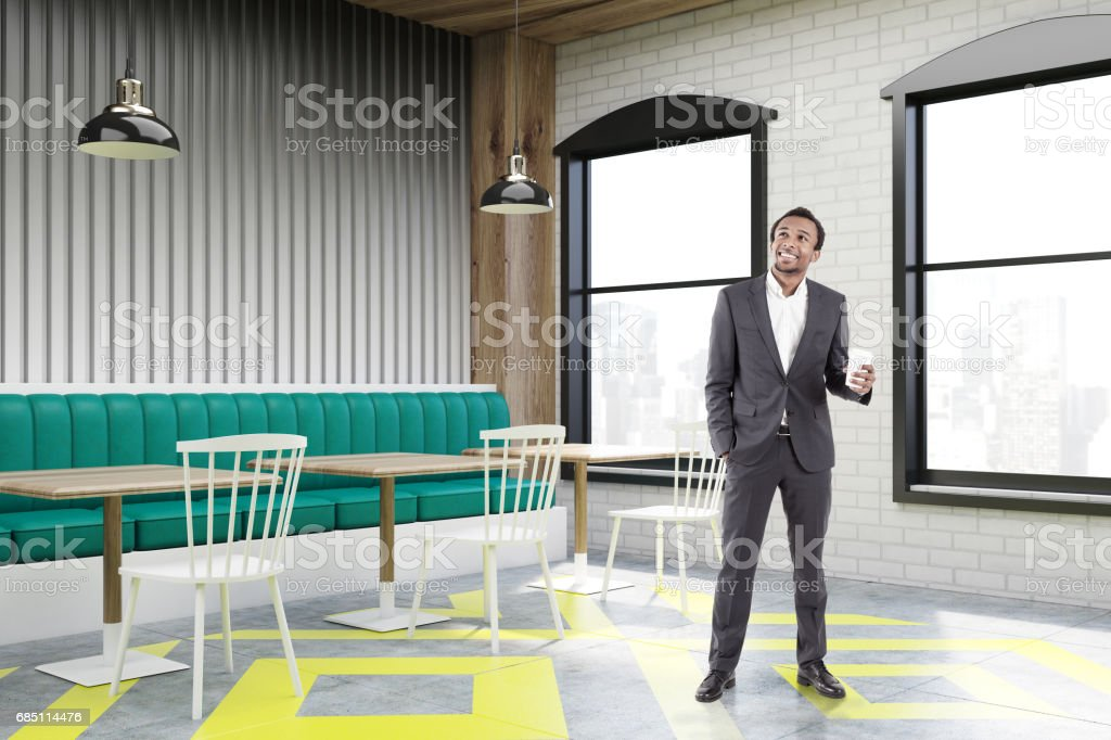 Corner of cafe with posters, gray, man royalty-free stock photo