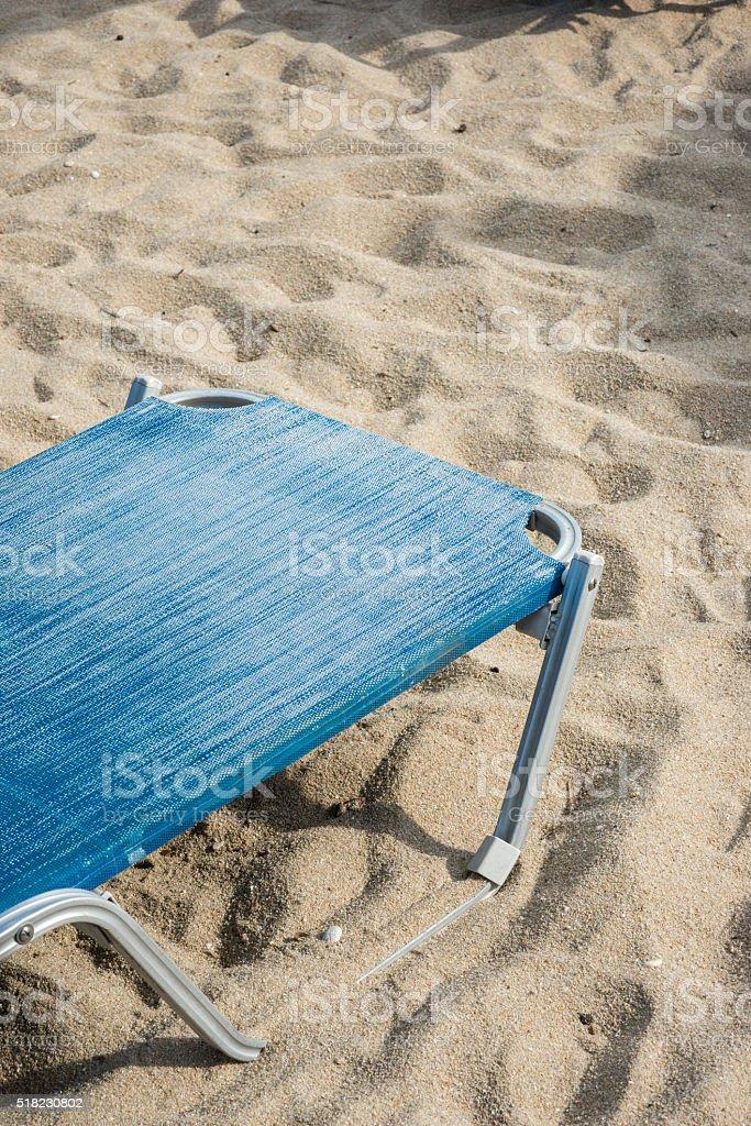 Corner of desckchair on sandy beach stock photo
