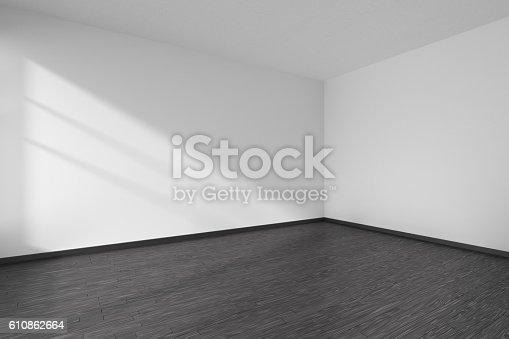 istock Corner of empty white room with black parquet floor 610862664