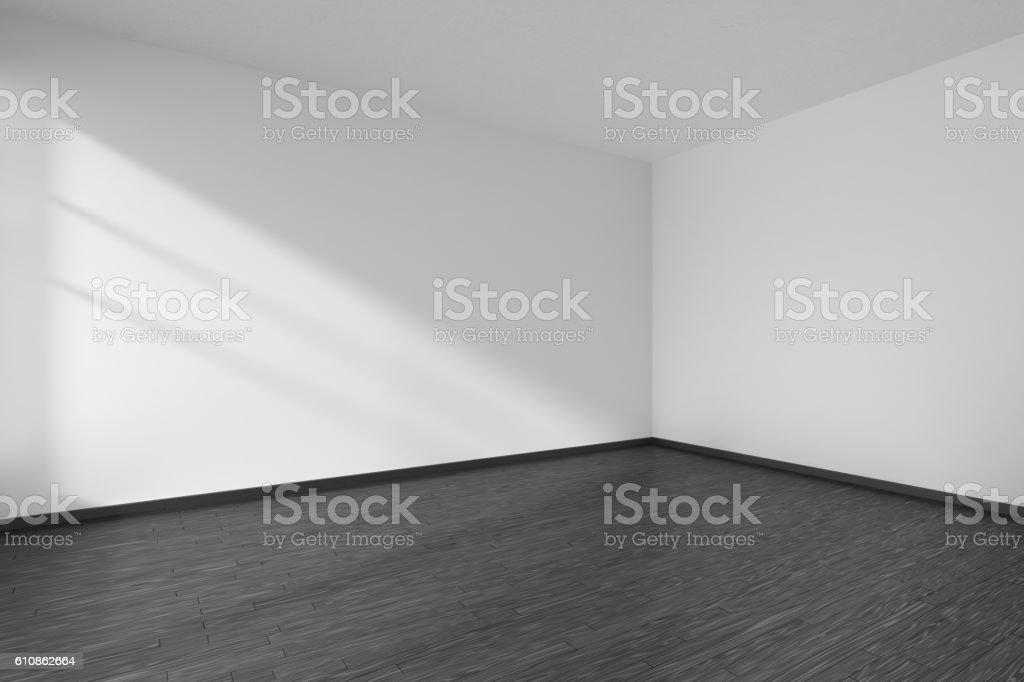 Corner of empty white room with black parquet floor stock photo