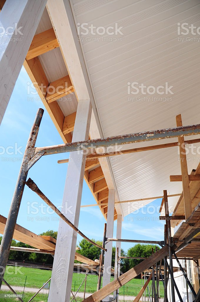 Corner of house construction with eaves, wooden beams. stock photo