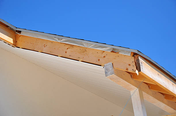 Corner of house with eaves. Install soffits against blue sky stock photo