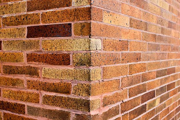 Corner of pink and brown brick wall stock photo