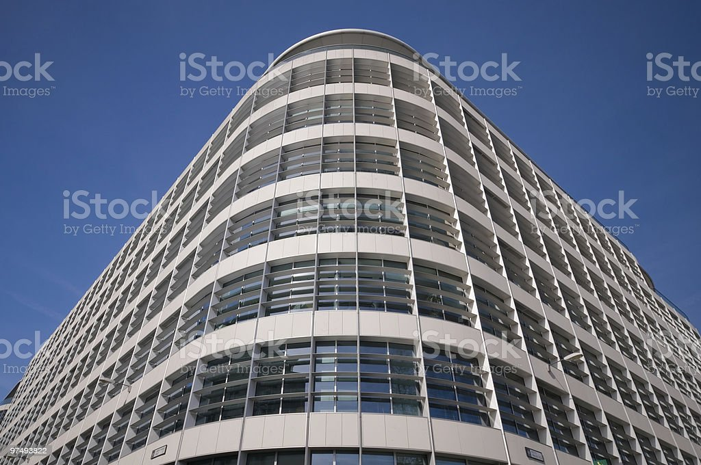 Corner of smart looking building against blue sky royalty-free stock photo