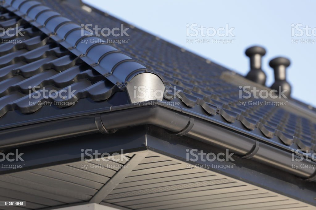 Corner of the house with gutter. stock photo