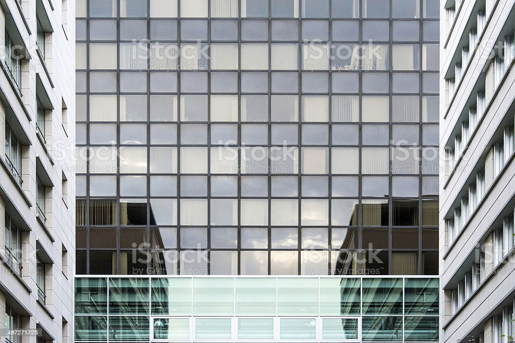 Corner of the modern building with glass windows stock photo
