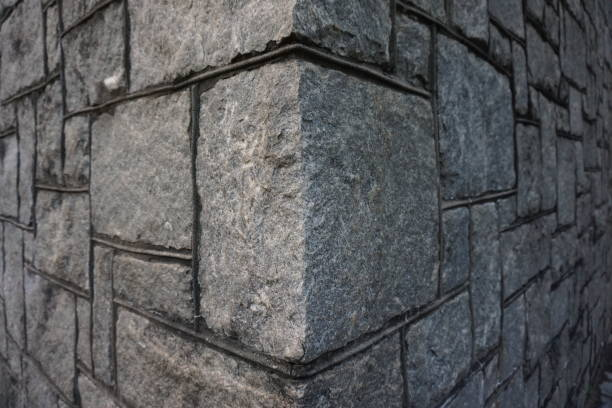 Corner stone Granite stone blocks forming a corner stable stock pictures, royalty-free photos & images