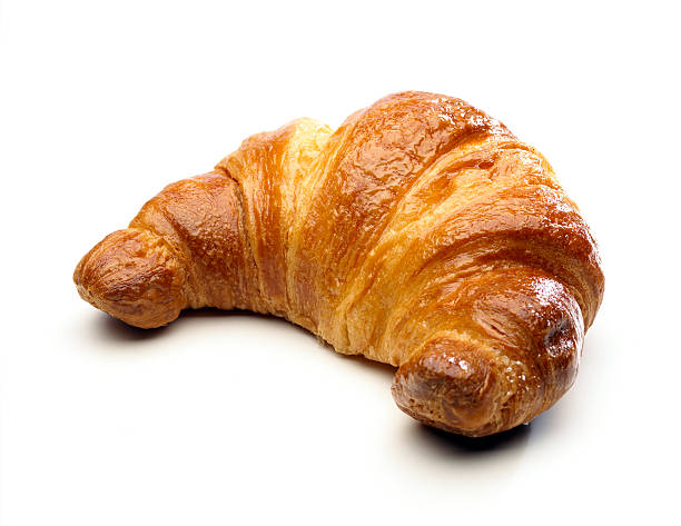 Cornetto bread against white background Cornetto (Croissant) isolated on white croissant stock pictures, royalty-free photos & images