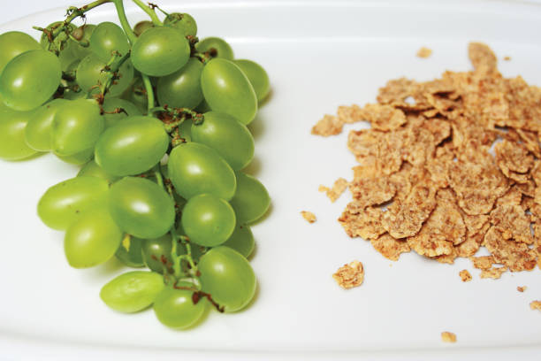 cornflakes and white grapes healthy diet eating stock photo