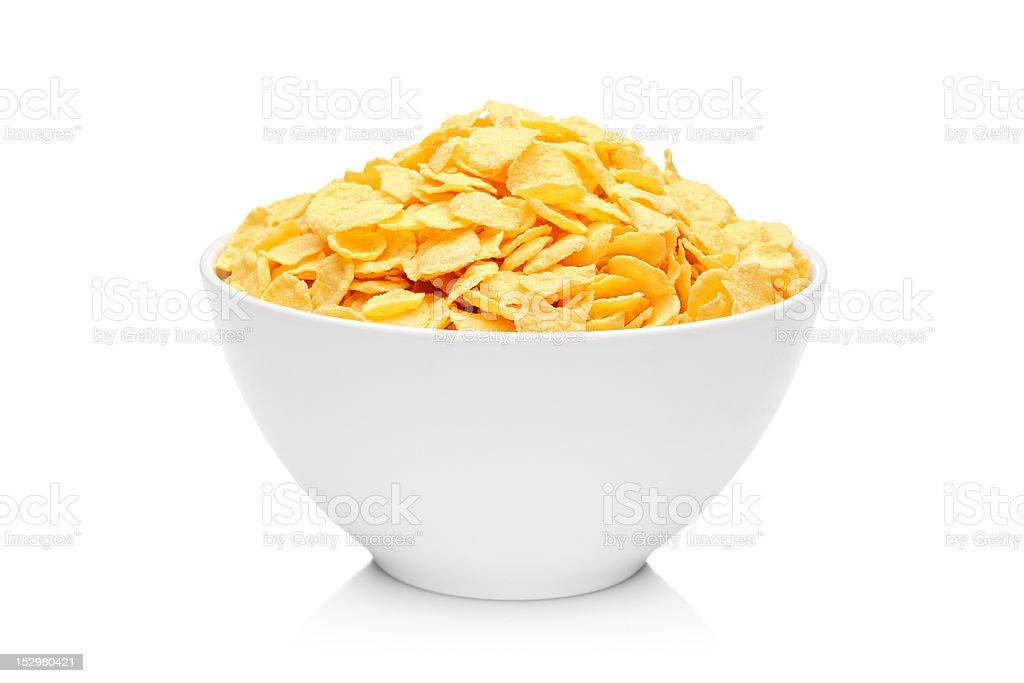 Cornflakes in porcelain bowl stock photo