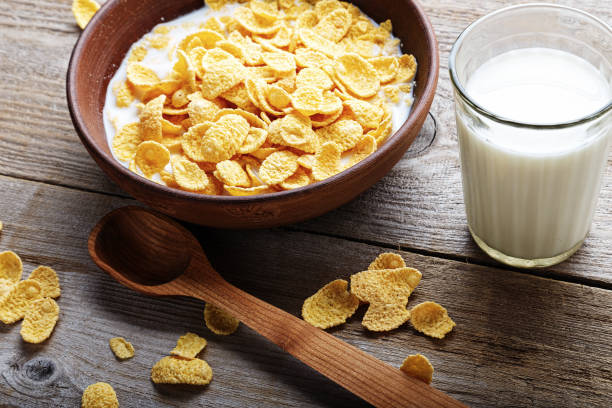 Cornflakes on a worn wooden background stock photo