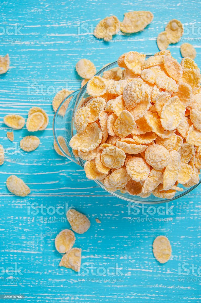 cornflakes on wooden table at morning stock photo
