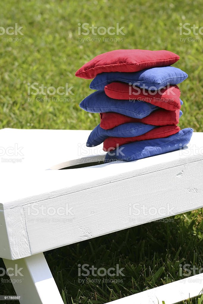 Cornhole bags stacked on a board stock photo