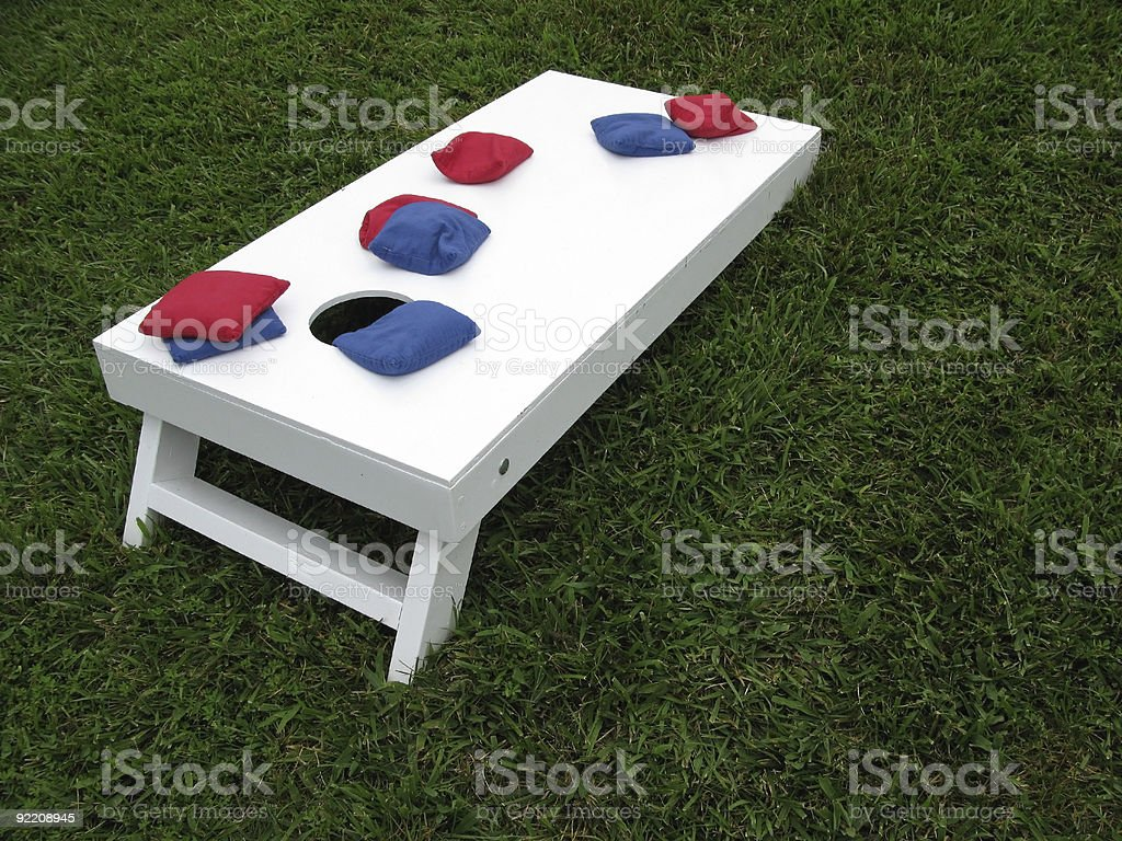 Cornhole board and eight bags stock photo