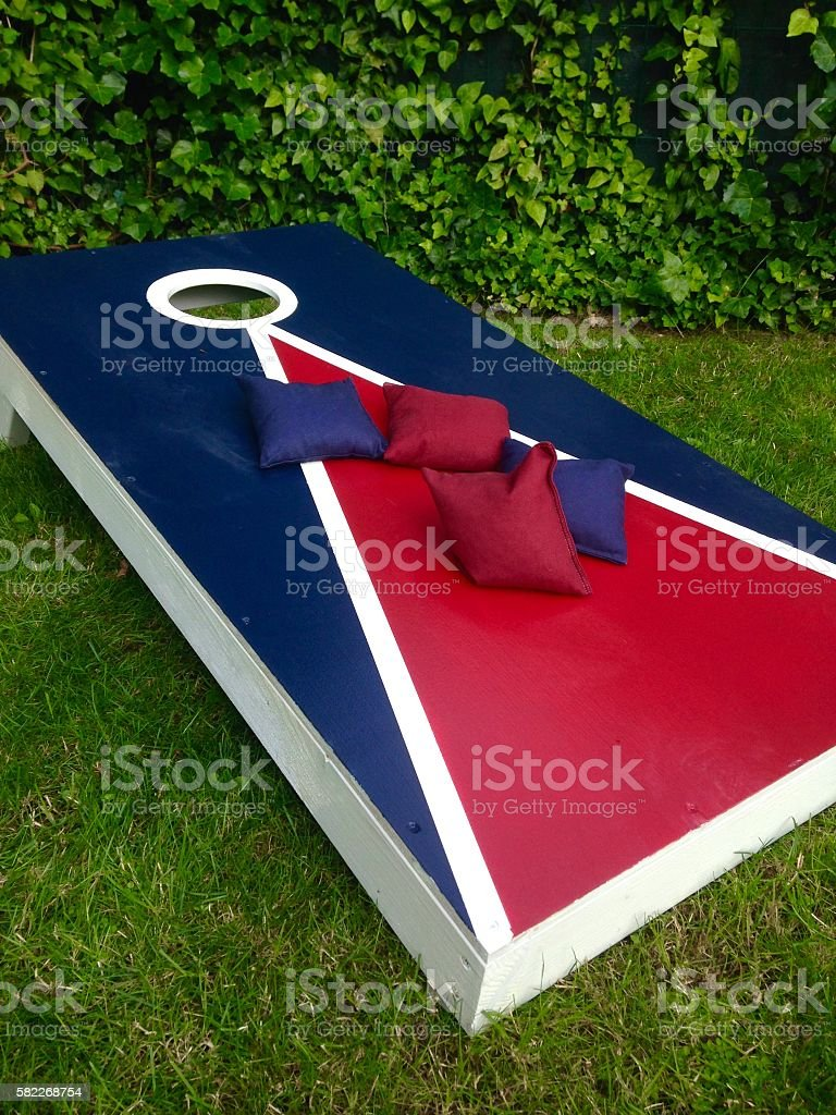 Cornhole Toss Game Board on Grass in Summer stock photo