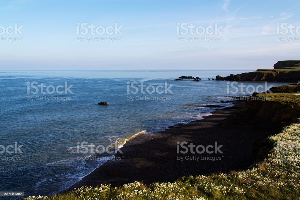 Cornish coastline viewed from the cliff in Bude stock photo