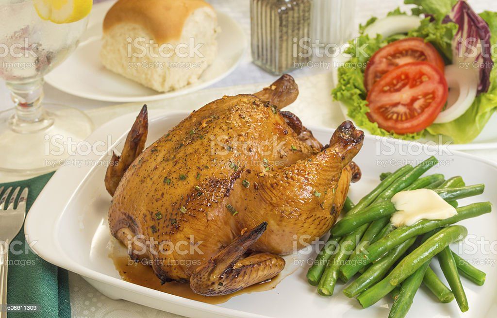 cornish game hen with fresh vegetables stock photo